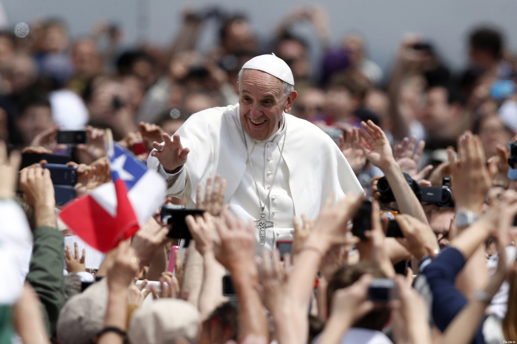 Pope Francis waves at the end of a mass in Saint Peter's Square at the Vatican